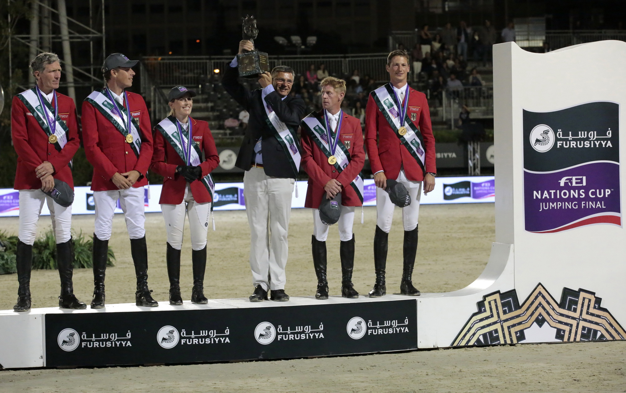 Team Germany, Furusiyya FEI Nations Cup™ 2016 champions, on the podium in Barcelona (ESP): (L to R) Ludger Beerbaum, Christian Ahlmann, Janne Friederike Meyer, Otto Becker (Chef d'Equipe), Marcus Ehning and Daniel Deusser. © FEI/Jim Hollander