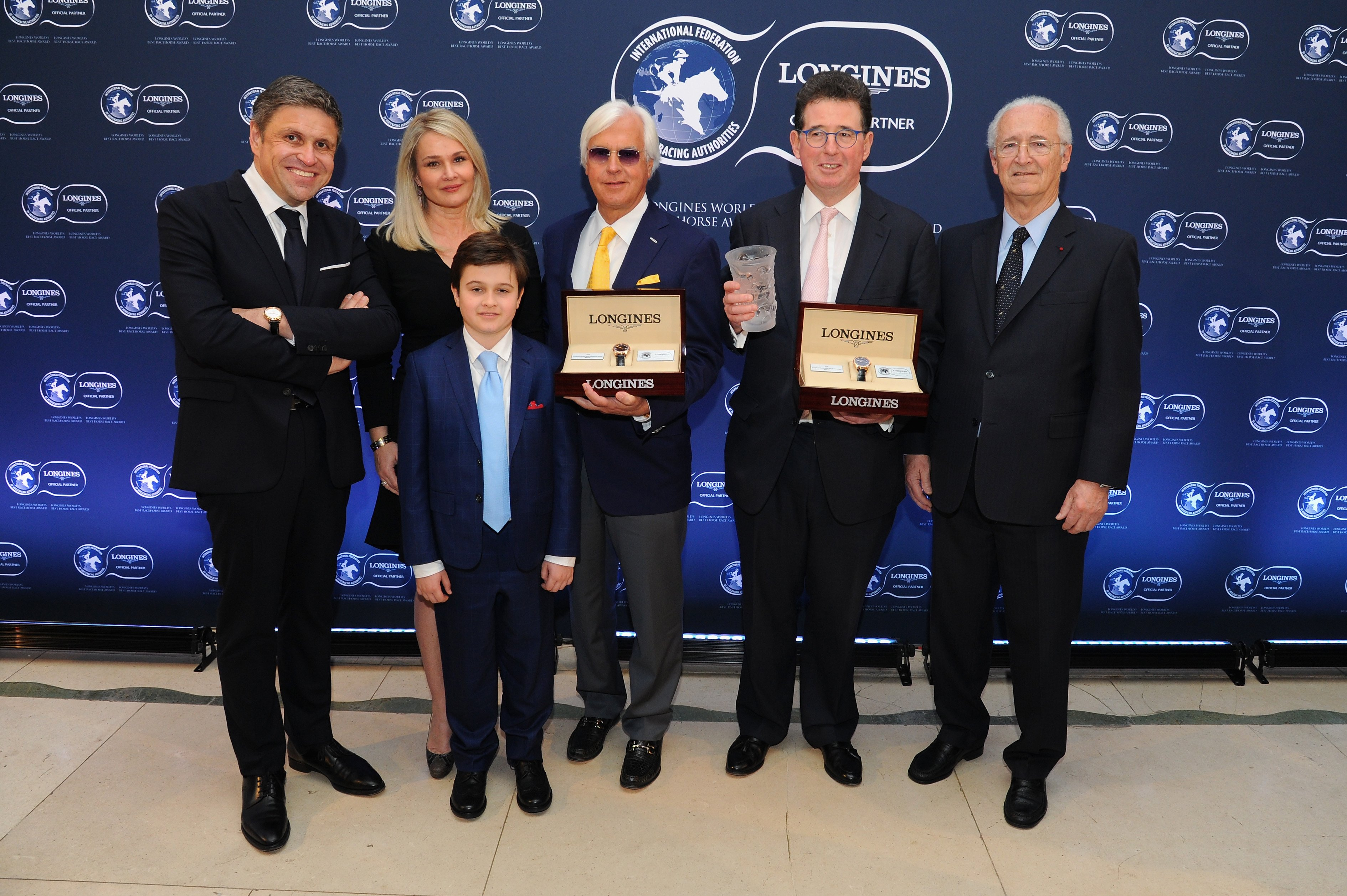 Bob Baffert (3rdR) and Lord Teddy Grimthorpe (2ndR) receive the Longines Worlds Best Horse Award from Mr. Juan-Carlos Capelli (L), Vice President of Longines and Head of International Marketing, and Mr. Louis Romanet (R), IFHA Chairman with Jill Baffert (2ndL) and Bode Baffert (3rdL)