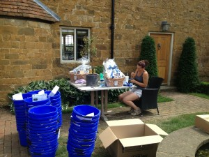 Charlotte Archibald preparing starter goodie buckets and prizes