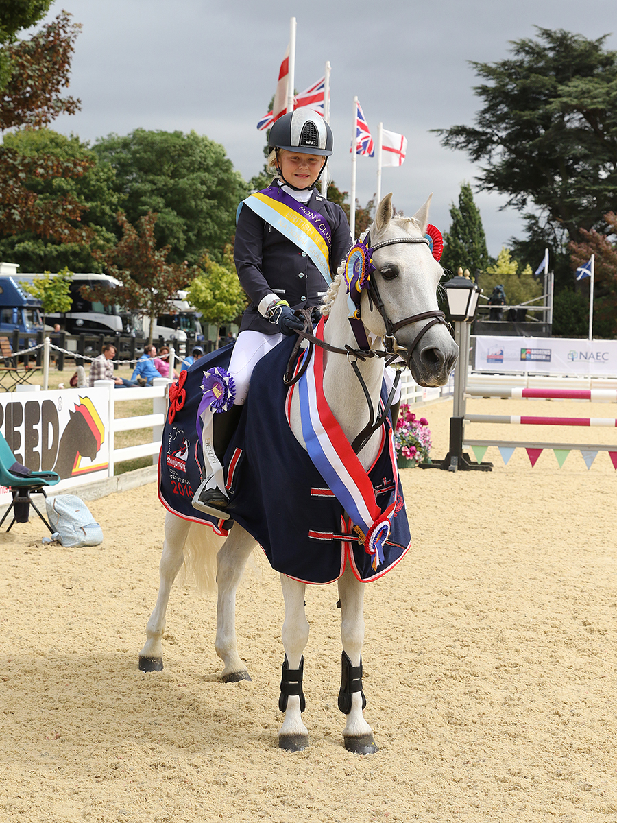 Ellie Burrell-Squibb riding Kitty, winners of the Bronze League 128cm Final © 1st Class Images