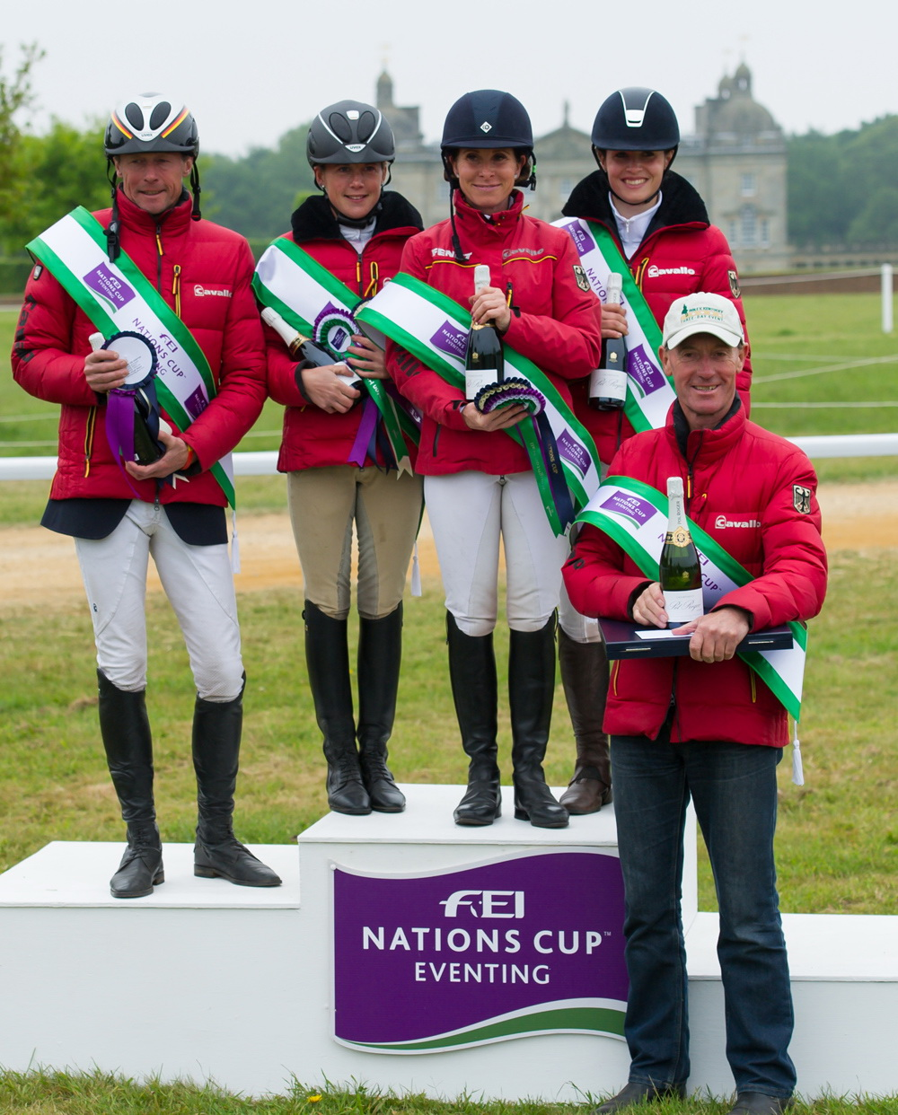 Germany, winners of the FEI Nations Cup™ Eventing at Houghton Hall (GBR) for the second year running (left to right): Peter Thomsen, Josefa Sommer, Bettina Hoy and Josephine Schnauffer, with their coach Christopher Bartle (Trevor Holt/FEI)