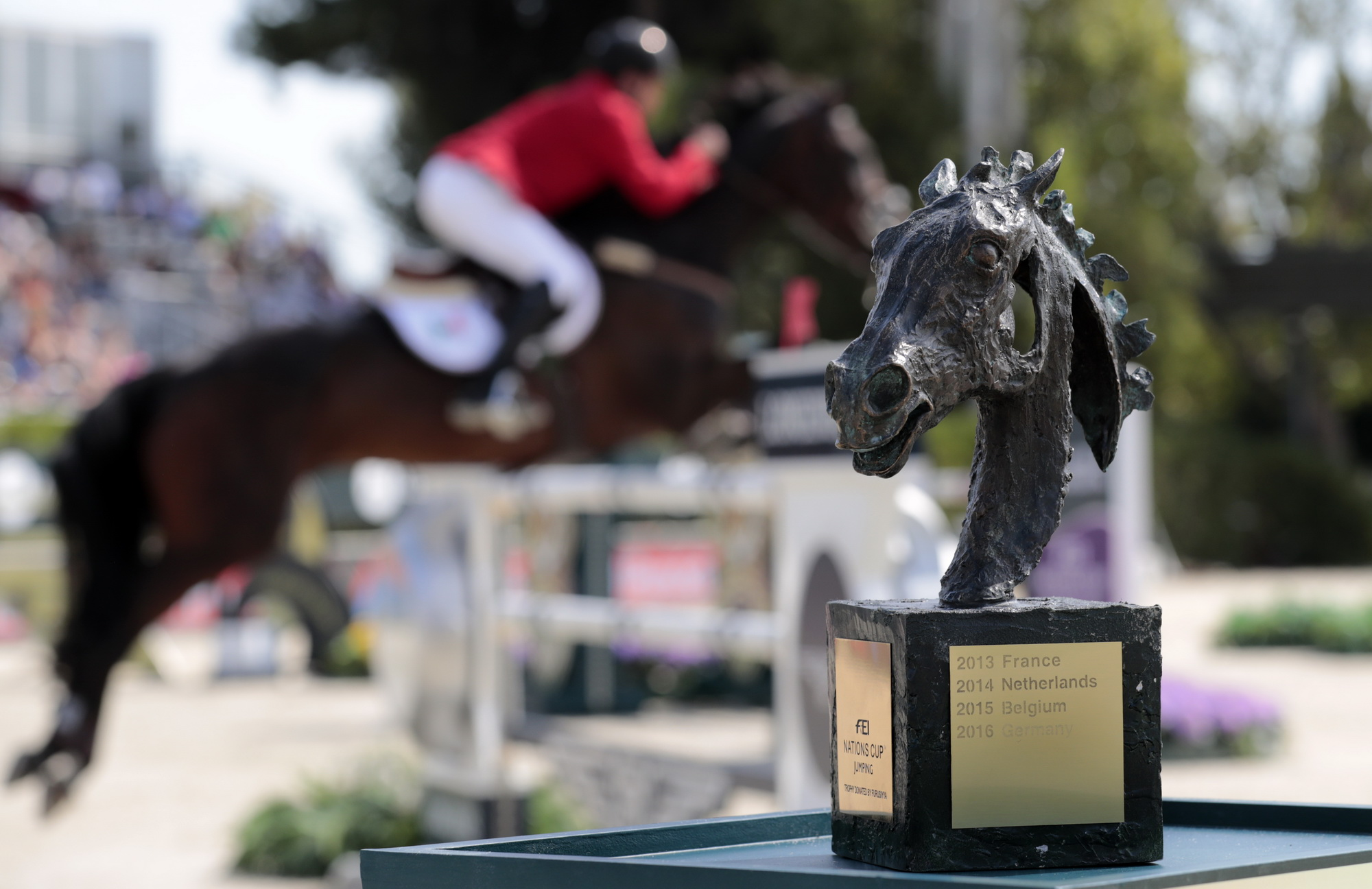 Mexico's Federico Fernandez riding Guru competes behind the FEI Nations Cup trophy