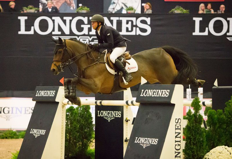 The United States' Kent Farrington repeats last year's National Horse Show victory with the win aboard Voyeur in the $250,000 Longines FEI World Cup™ Jumping Lexington. © FEI/Anthony Trollope