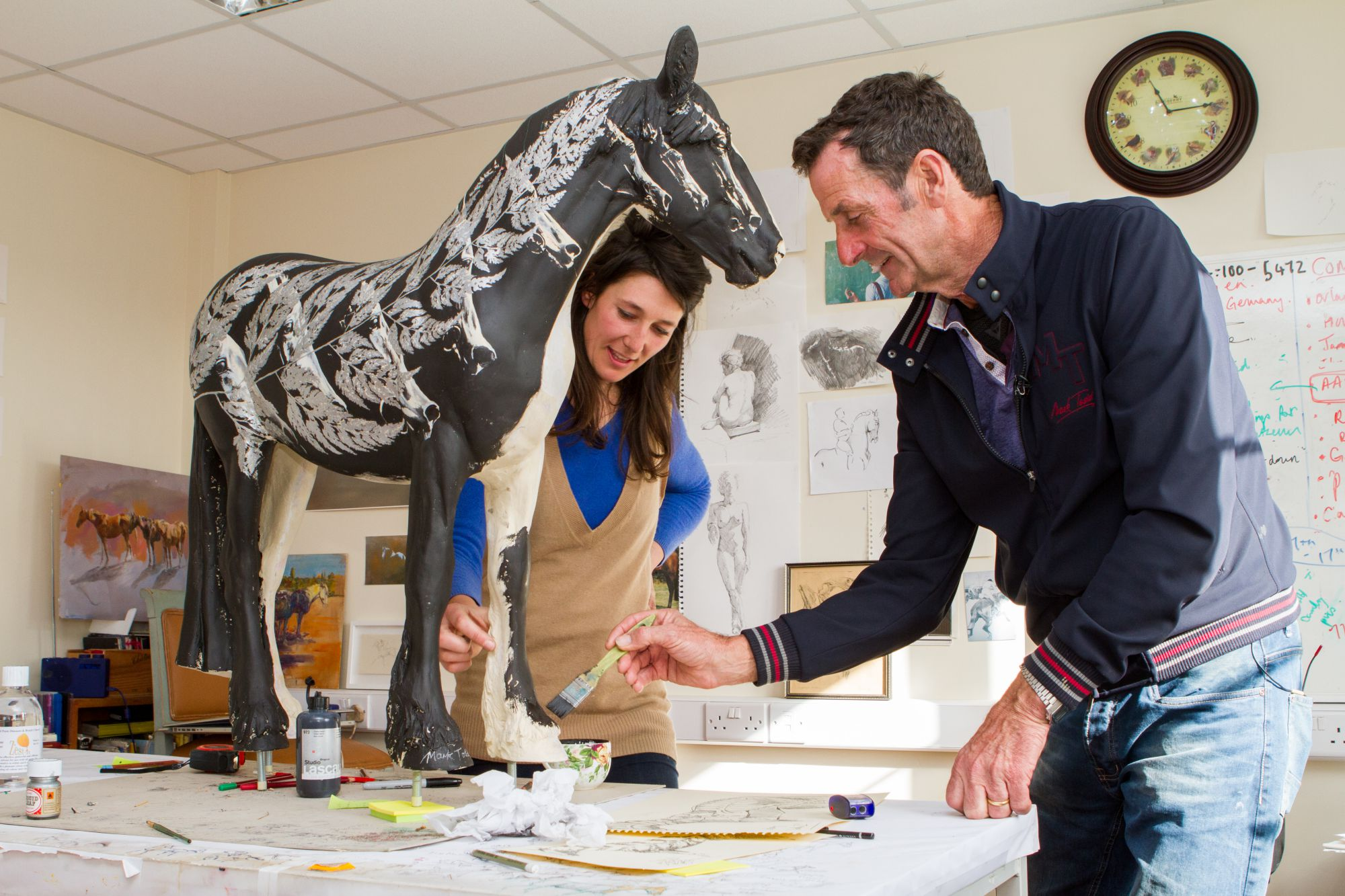 Sir Mark Todd and Michelle McCullagh paint the horse sculpture