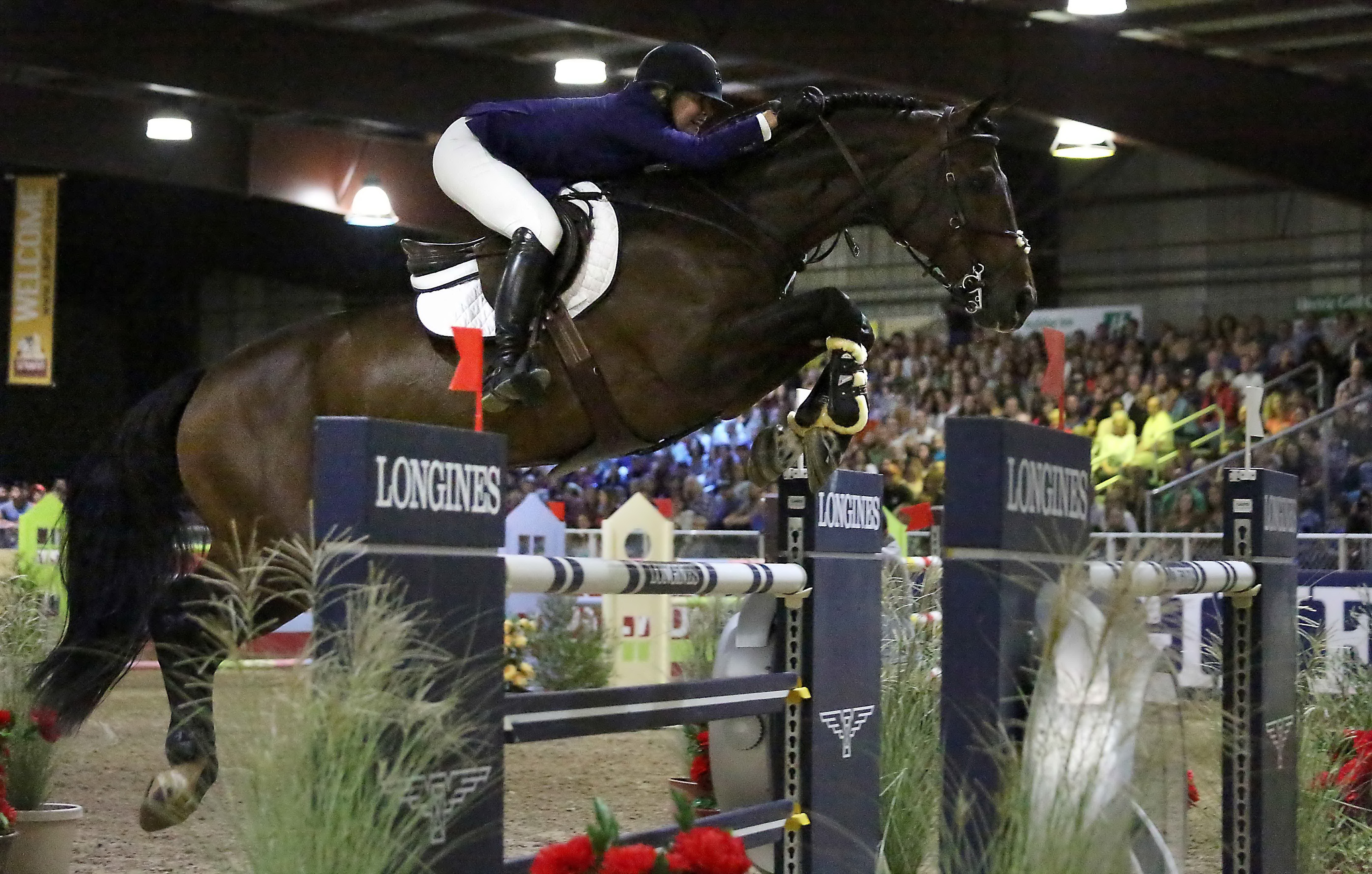 The United States' Audrey Coulter and Capital Colnardo jump to victory in the $100,000 Longines FEI World Cup™ Jumping Sacramento, Ca. (USA) © FEI/Kristin Lee