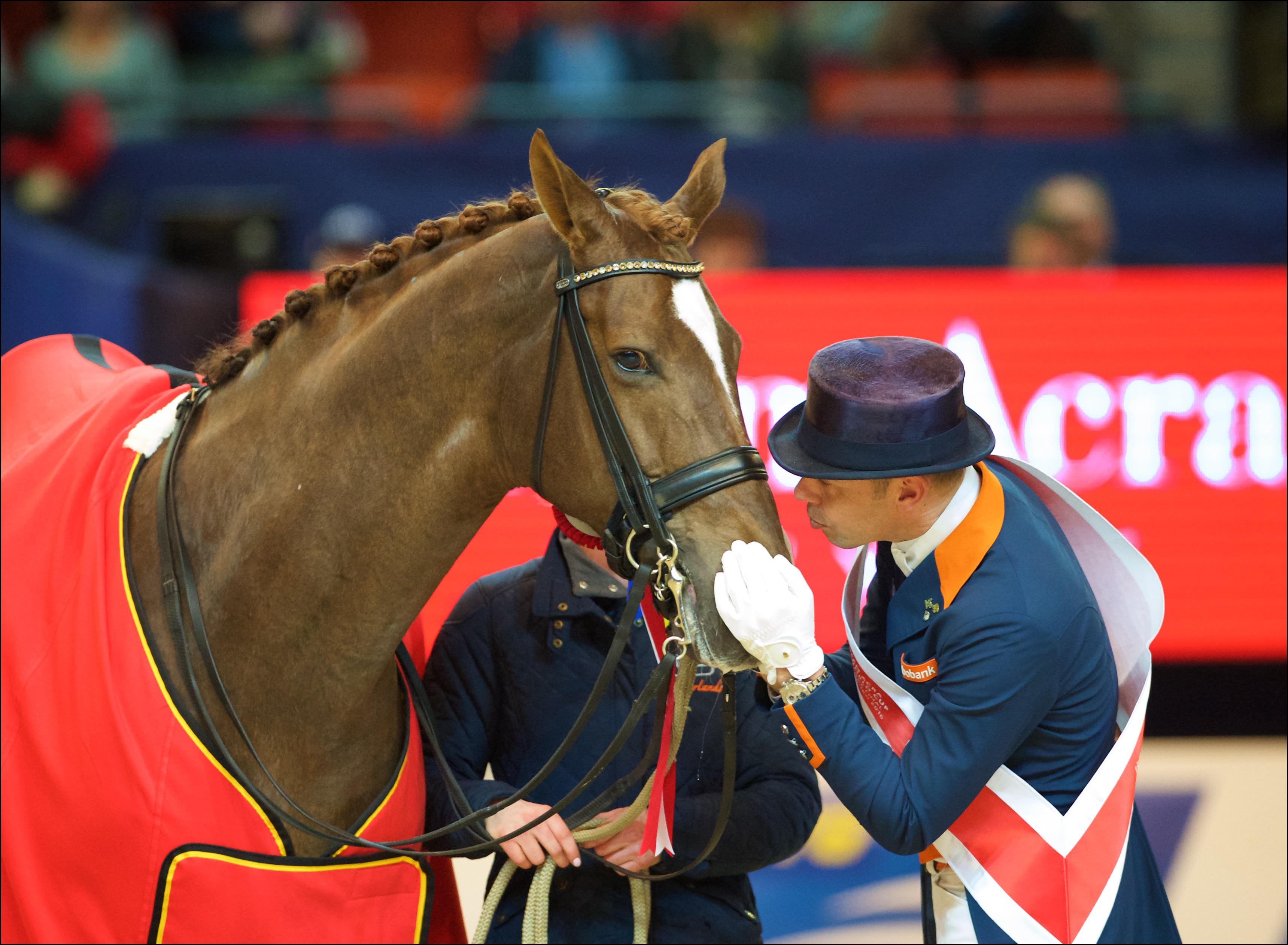 Hans Peter Minderhoud and Glock's Flirt enjoy a #TwoHearts moment after claiming the Reem Acra FEI World Cup™ Dressage 2016 title at Gothenburg (SWE) last March. © Arnd Bronkhorst/FEI