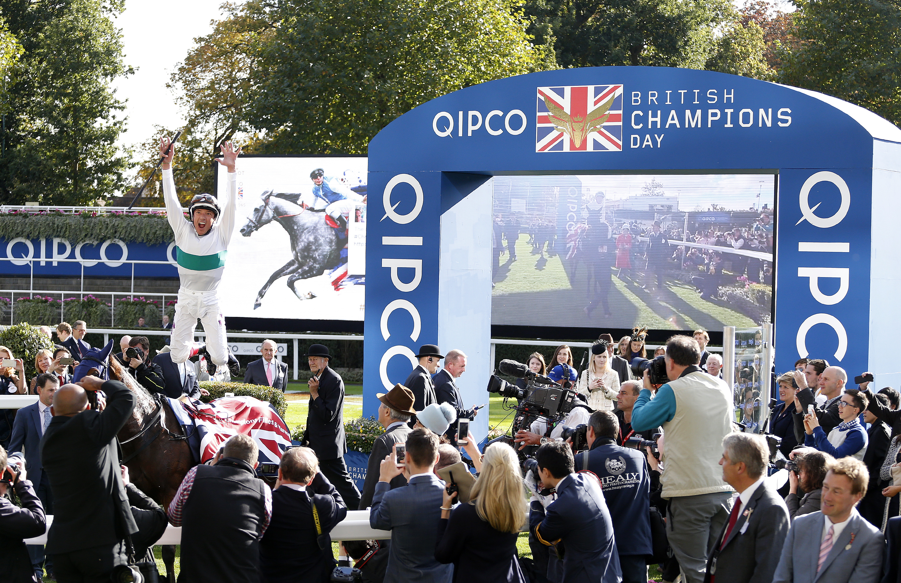 Frankie Dettori leaps from Journey after winning The Qipco British Champions Fillies Mares Stakes at Ascot Racecourse © Alan Crowhurst/Getty Images