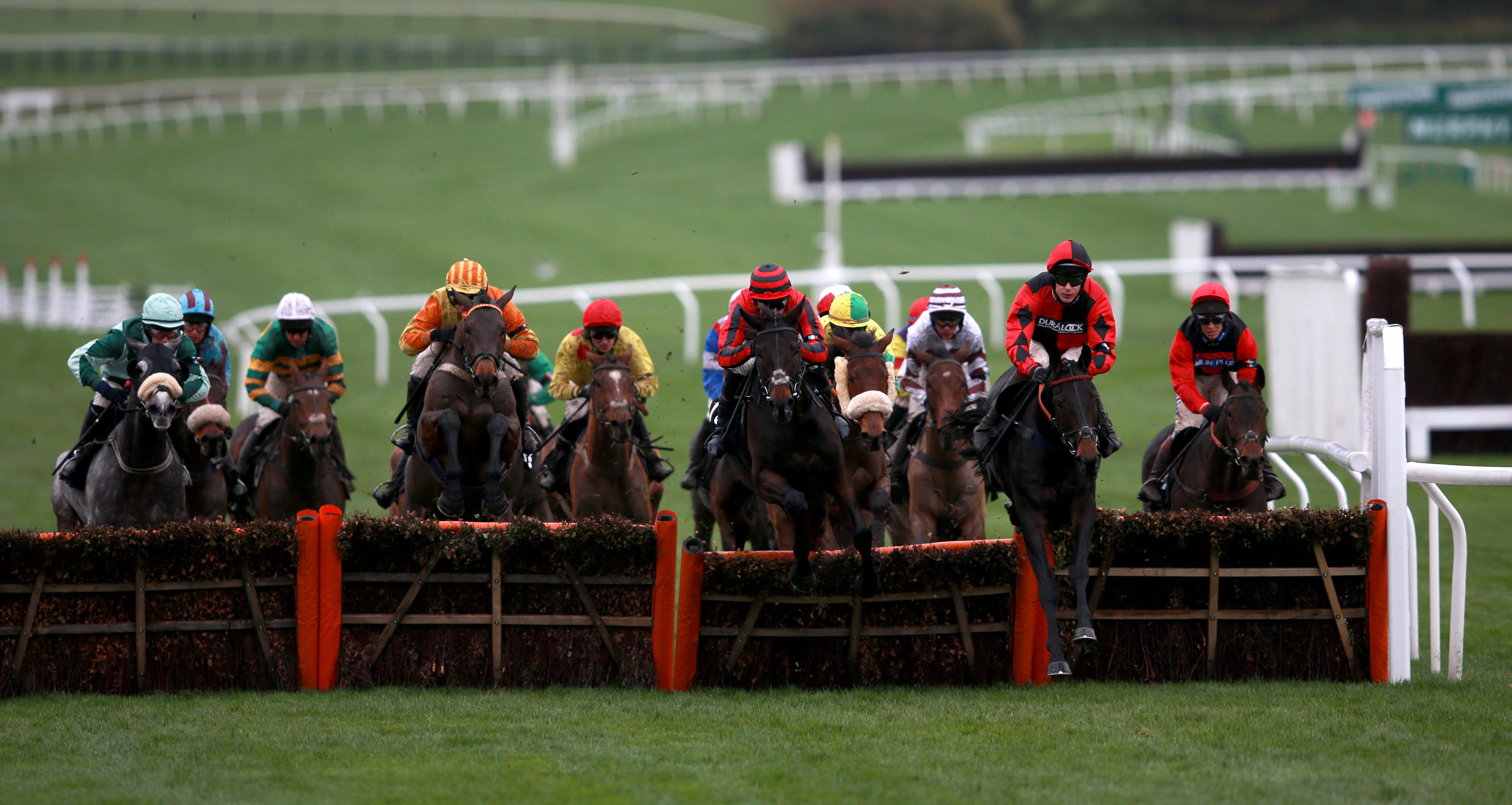 Sir Mangan (right) ridden by Harry Skelton jumps the fence during the Regulatory Finance Solutions Handicap Hurdle © David Davies/PA Wire/Cheltenham Racecourse